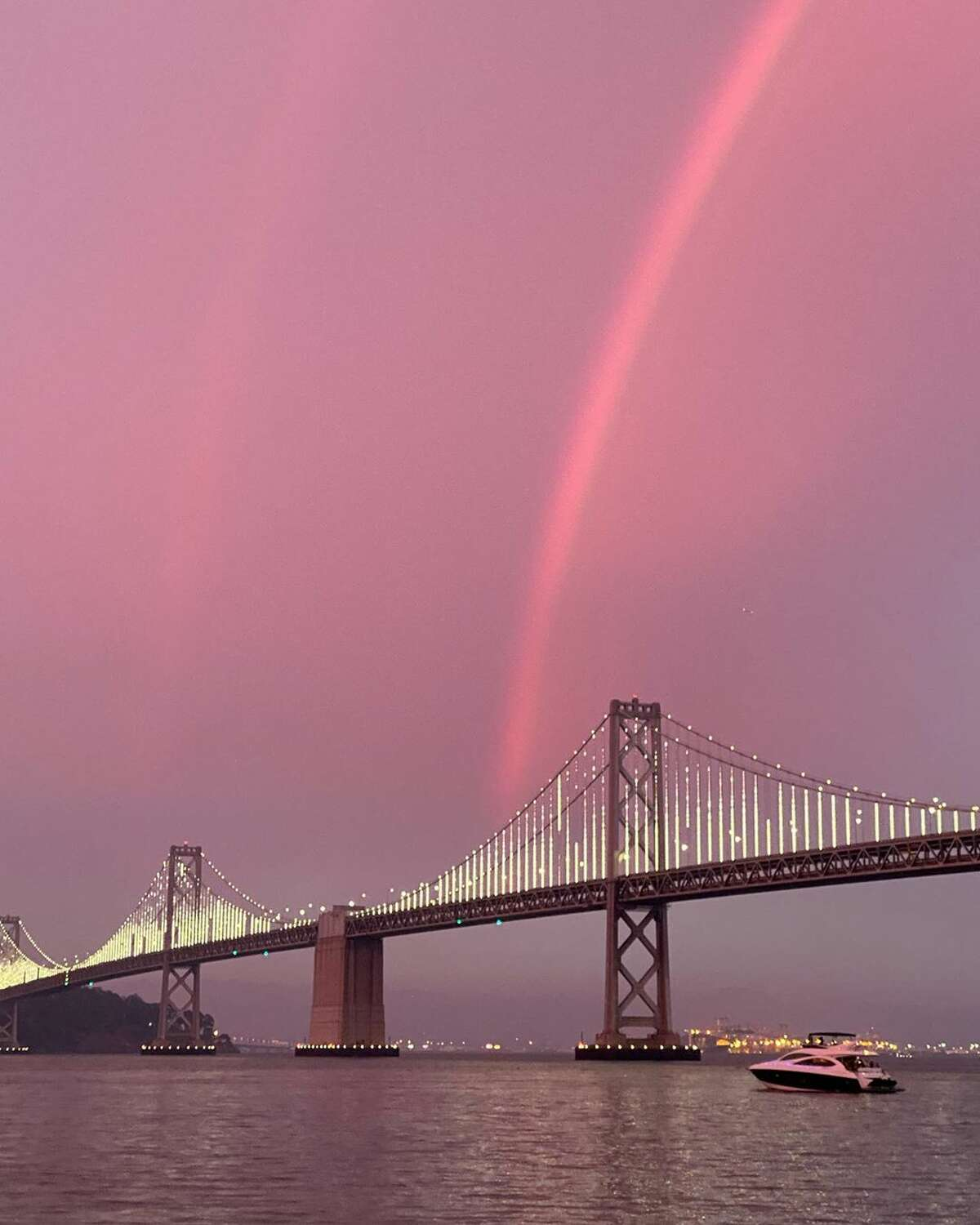 An apparent double rainbow during sunset over the Bay Bridge on Sunday, Aug. 23, 2020, as wildfires raged across California.(Photo: fashionablya / Instagram )