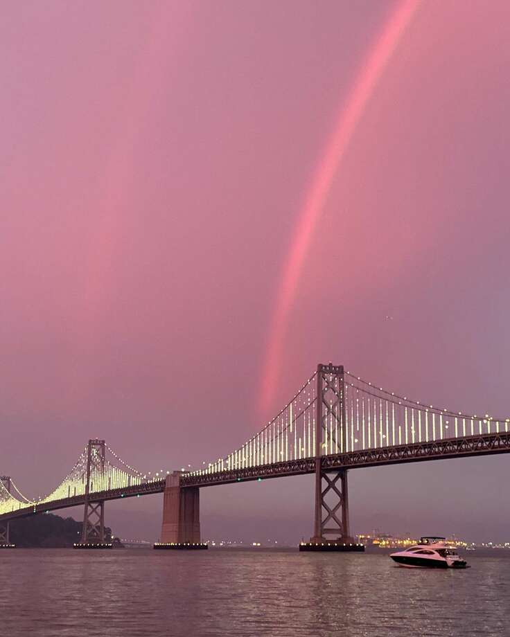 An apparent double rainbow during sunset over the Bay Bridge on Sunday, Aug. 23, 2020, as wildfires raged across California.(Photo: fashionablya / Instagram ) Photo: Fashionablya / Instagram