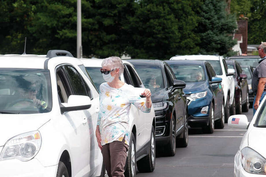 Linda Reining chats while waiting for Sunday's prayer parade to begin. The parade started at Eisenhower Middle School and stopped at each school in the Jacksonville school district. More than 20 cars were in the parade. Photo: Darren Iozia | Journal-Courier