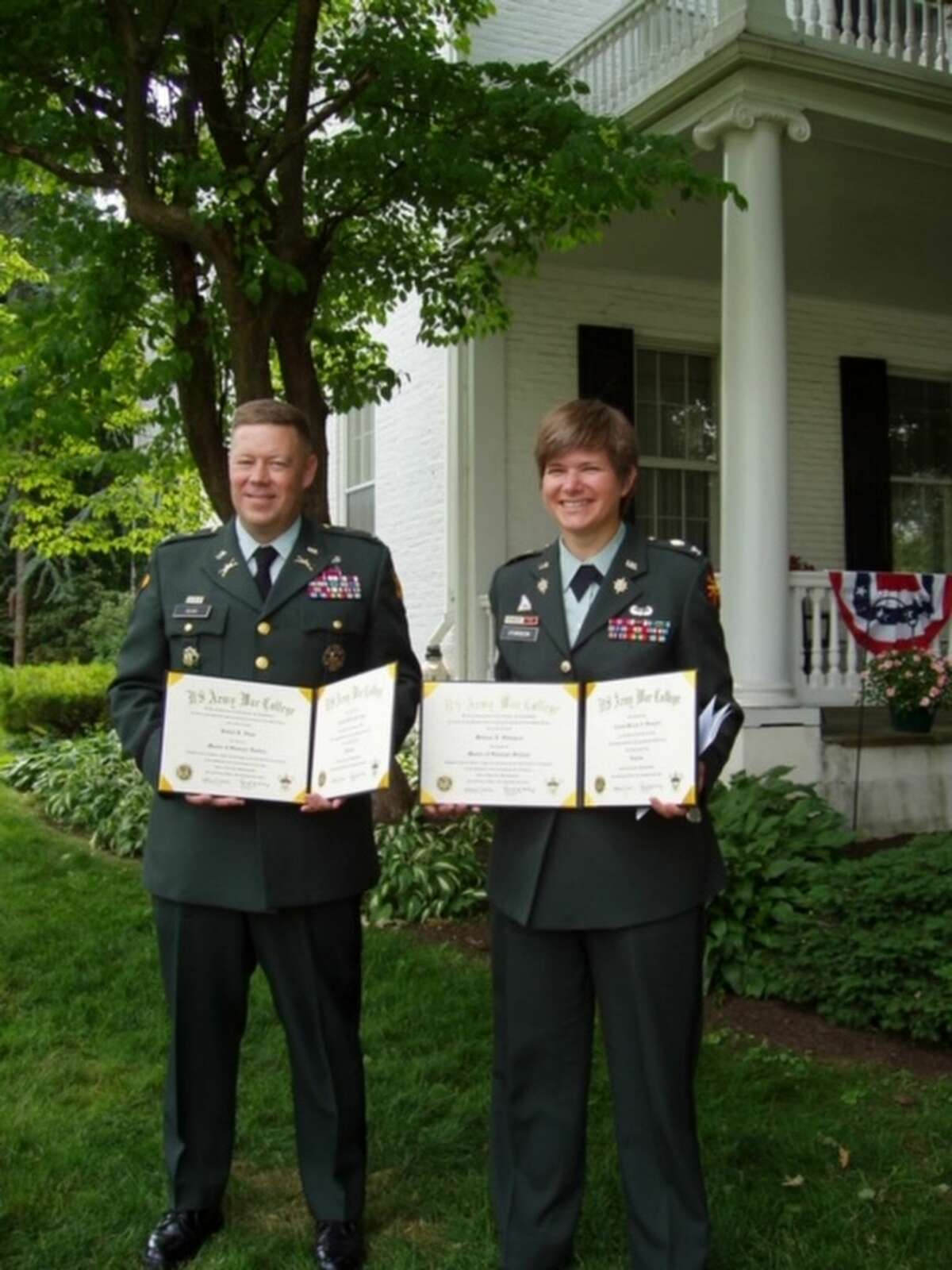 Col. Bob Akam, left, and Col. Melissa Sturgeon graduate from the US Army War College in Carlisle Barracks, PA in May of 2007 in an undated courtesy photo provided by Col. Bob Akam.