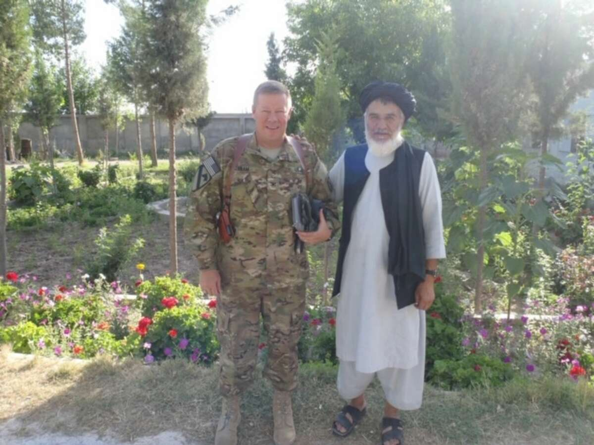 Combined Team Uruzgan Commander Col. Bob Akam, left, and former Uruzgan Provincial Governor Kodi Rahim Kahn after a local tribal chiefÃ?•s conference at the governorÃ?•s compound in an undated courtesy photo provided by Col. Bob Akam.