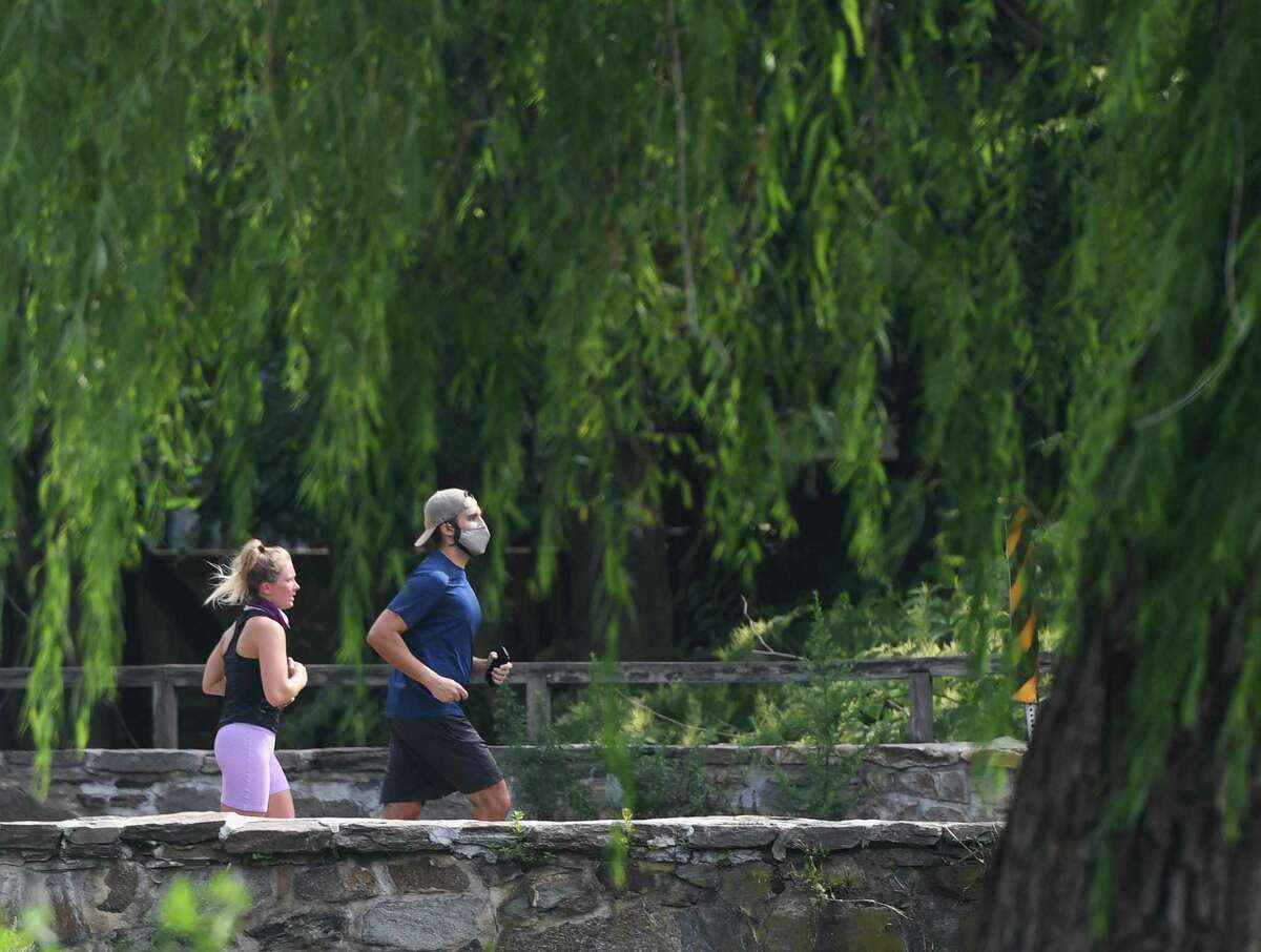 Stamford's Susie Gardiner and Connor Warren participate in the #IRunWithMaud 2.23 mile run at Binney Park in Old Greenwich, Conn. Sunday, Aug. 23, 2020. Organized by Stamford civil rights group Justice for Brunch, the run was held in honor of Ahmaud Arbery, a Black man who was shot and killed by three white men while jogging near his home in Georgia. The 2.23 mile distance is symbolic of the date that Arbery was killed, February 23, 2020.