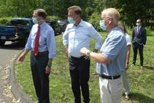 U.S. Senator Richard Blumenthal, left, Governor Ned Lamont and Mayor Mark Boughton, right, view damage from Tuesday's tropical storm Isaias on Judith Drive ,Friday, August 7, 2020, in Danbury, Conn.