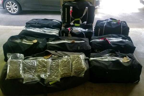 State Police said they found 471 pounds of marijuana stuffed in hockey bags and hidden in two cars they stopped Thursday, Aug.20, 2020, on Route 30 in Mayfield.