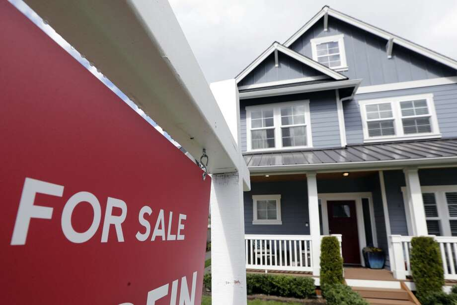 One of the title company's roles is to research the title of a home and verify that the buyer has the legal right to sell the property. Photo: Elaine Thompson/Associated Press / Copyright 2020 The Associated Press. All rights reserved