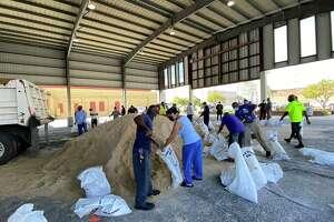 People fill sandbags at the Pavilion in Port Arthur August 24, 2020. Photo: Kim Brent/The Enterprise