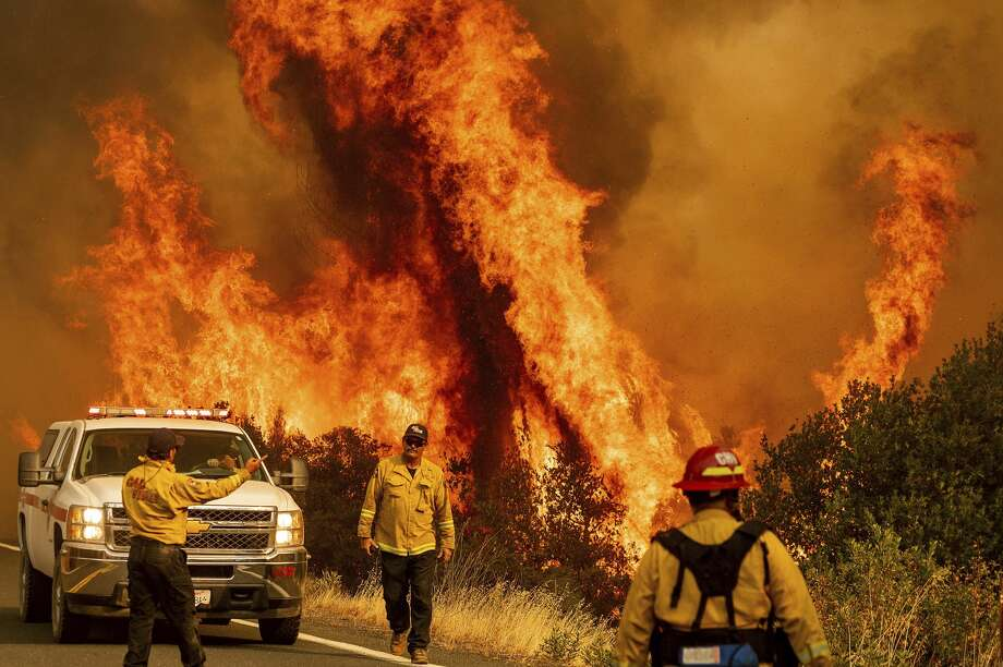 Flames from the LNU Lightning Complex fires leap above Butts Canyon Road on Sunday, Aug. 23, 2020, as firefighters work to contain the blaze in unincorporated Lake County, Calif. Photo: Noah Berger/Associated Press / Noah Berger