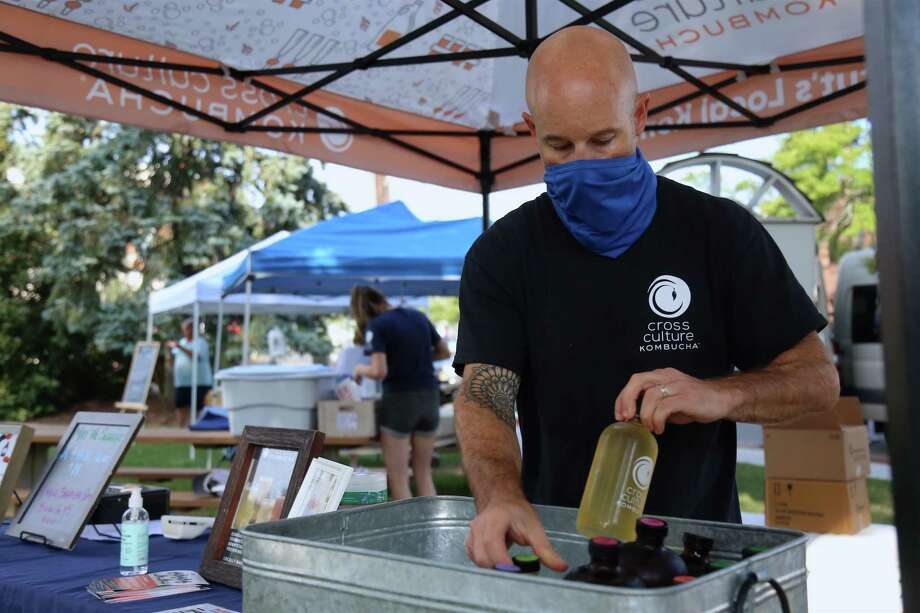 Ian Ceppos of Danbury-based Cross Culture Kombucha puts out some of his product at the Fairfield Farmers Market on Sunday, Aug. 23, 2020, in Fairfield, Conn. Photo: Jarret Liotta / Jarret Liotta / ©Jarret Liotta 2020