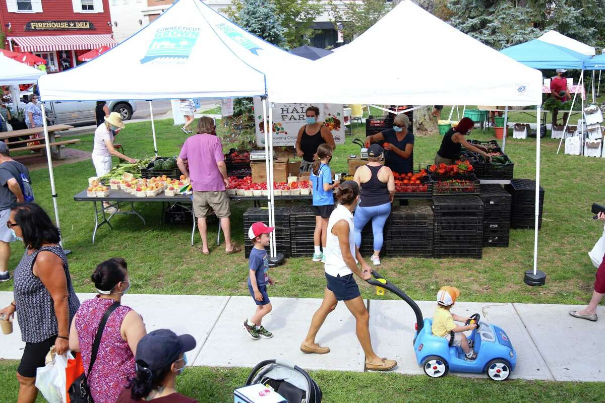 It was a sunny day for visitors at the Fairfield Farmers Market on Sunday, Aug. 23, 2020, in Fairfield, Conn.