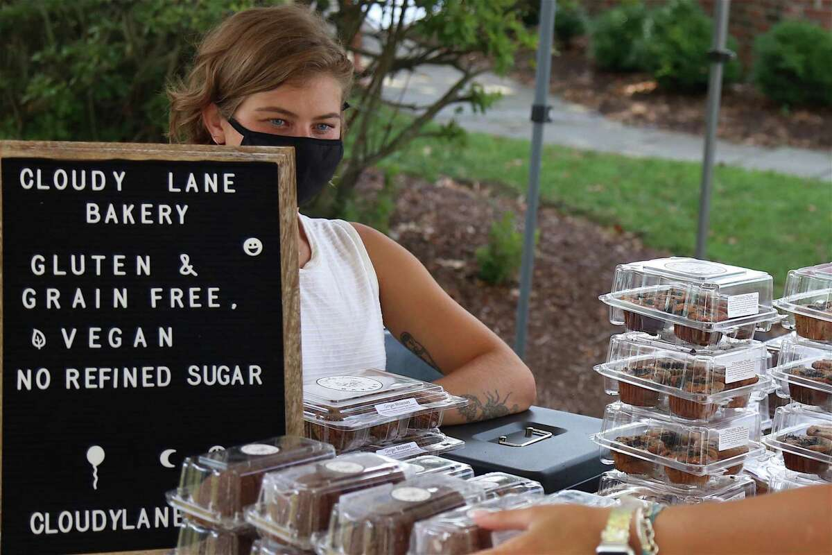 Dani LeBlanc of the Westport-based Cloud Lane Bakery fields questions from a customer at the Fairfield Farmers Market on Sunday, Aug. 23, 2020, in Fairfield, Conn. Dani LeBlanc, owner of Westport-based Cloud Lane Bakery, said the Fairfield Farmers Market stands out from the crowd.