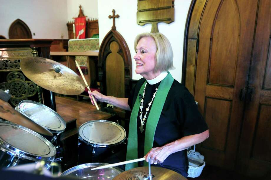 The Rev. Barbara Cheney plays the drums with the church band at the beginning of Sunday morning services at St. James Episcopal Church in New Haven in 2012. Photo: Arnold Gold / Hearst Connecticut Media File