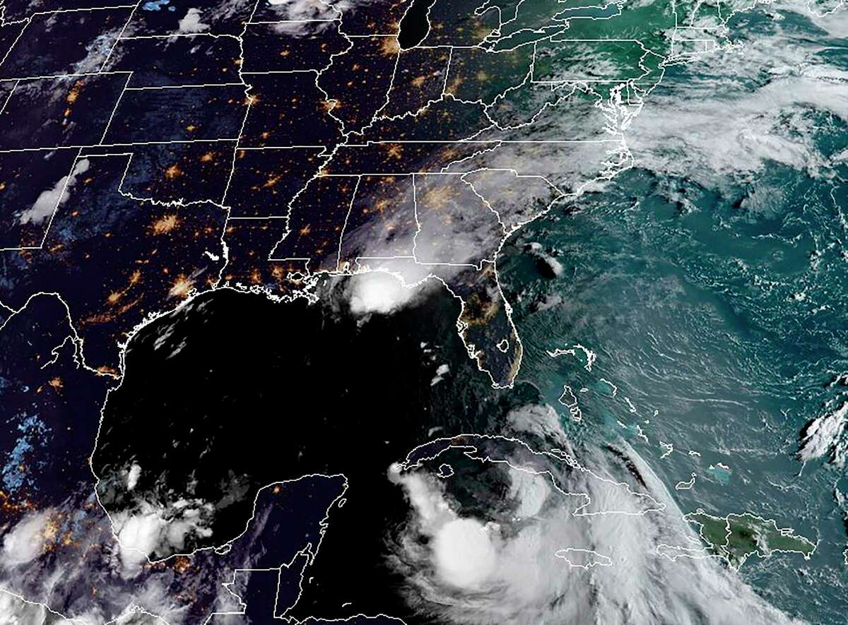 """This RAMMB/NOAA satellite image obtained on August 24, 2020, shows Tropical Storm Laura moving west-northwesward south of Cuba(R) and Hurricane Marco in the US Gulf Coast(above)at 11:50 UTC on August 24, 2020 - Tropical Storm Marco strengthened into a hurricane with winds of 75 miles (120 kilometers) per hour, and is forecast to hit the state of Louisiana on Monday.Tropical Storm Laura hammered Haiti and the Dominican Republic with heavy rain, killing at least 12 people -- 9 in Haiti and three in the Dominican Republic. It was set to become a hurricane on Tuesday that could hit the US coastal region on Wednesday. (Photo by Handout / RAMMB/NOAA/NESDIS / AFP) / RESTRICTED TO EDITORIAL USE - MANDATORY CREDIT """"AFP PHOTO / RAMMB/NOAA"""" - NO MARKETING - NO ADVERTISING CAMPAIGNS - DISTRIBUTED AS A SERVICE TO CLIENTS (Photo by HANDOUT/RAMMB/NOAA/NESDIS/AFP via Getty Images)"""