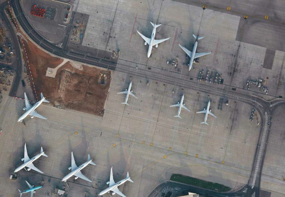 An aerial picture shows grounded airplanes on the tarmac of Ben Gurion International Airport in Lod, east of Tel Aviv on August 8, 2020, a usually busy airport, currently inactive due to COVID-19 restrictions. (Photo by GIL COHEN-MAGEN / AFP) (Photo by GIL COHEN-MAGEN/AFP via Getty Images)