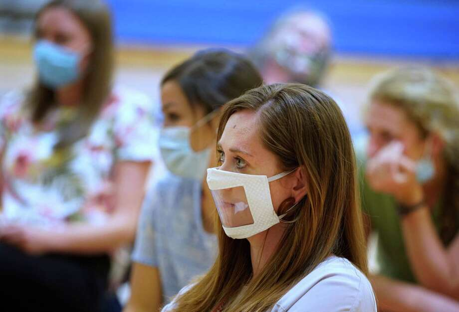 Masked teachers gather in the gym Aug. 12 for a beginning-of-the-year meeting at Freedom Preparatory Academy in Provo, Utah. Photo: George Frey / Getty Images / 2020 Getty Images