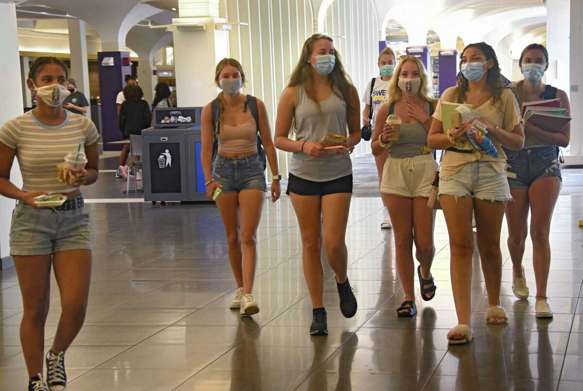 Students wear masks as they walk through the dining hall in the campus center at University at Albany on Monday, Aug. 24, 2020 in Albany, N.Y. Students start their first day of class in the first semester. (Lori Van Buren/Times Union)