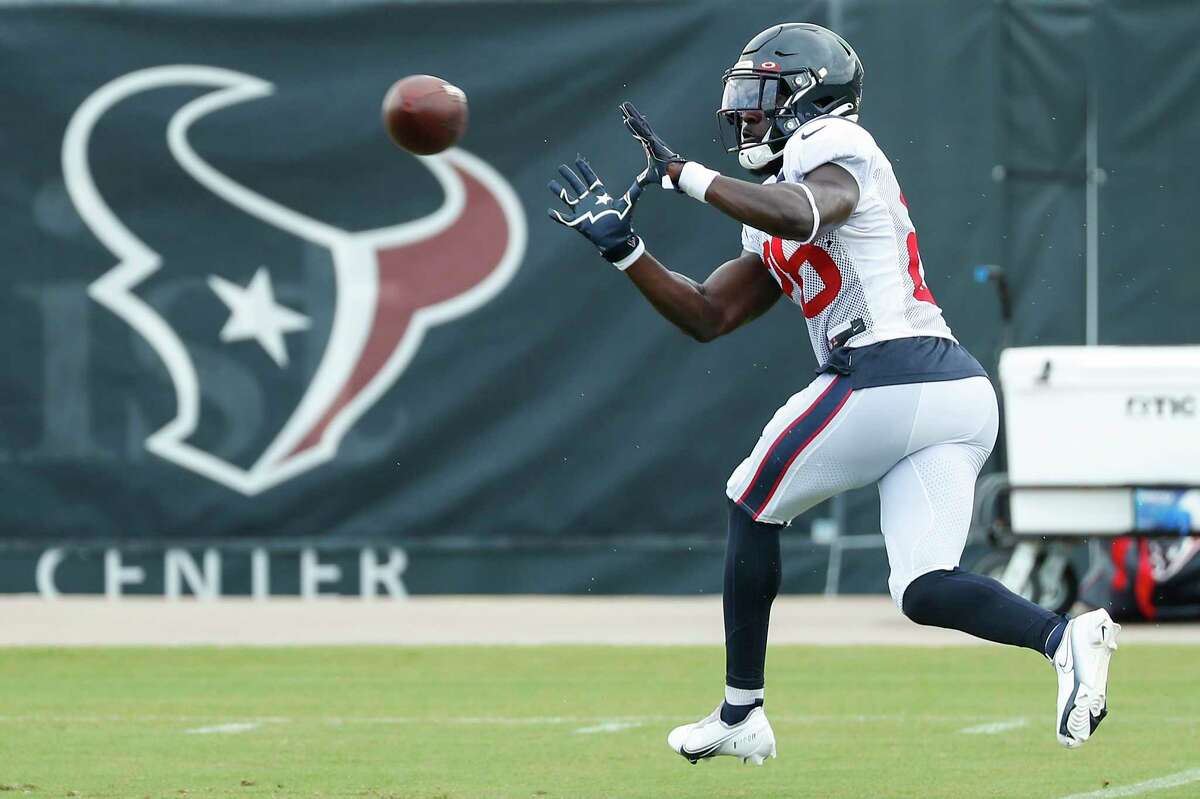 Houston Texans safety Michael Thomas reaches out to make a catch while running a pass coverage drill during an NFL training camp football practice Monday, Aug. 24, 2020, in Houston.