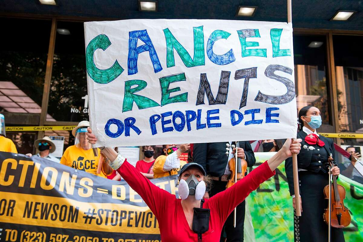 Renters and housing advocates attend a protest to cancel rent and avoid evictions amid the coronavirus pandemic in front of the courthouse in Los Angeles on Aug. 21, 2020.