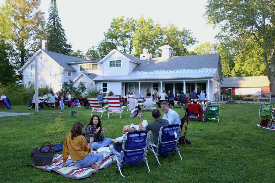 Friends enjoy the time together at the picnic dinner and music event at Wakeman Town Farm on Wednesday, Aug. 19, 2020, in Westport, Conn. Photo: Jarret Liotta / Jarret Liotta / ©Jarret Liotta 2020