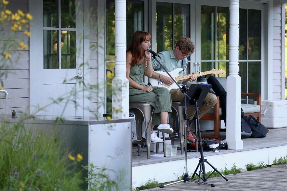 Margot Liotta and Zach Rogers, both of Westport, performed at the picnic dinner and music event at Wakeman Town Farm on Wednesday, Aug. 19, 2020, in Westport, Conn.