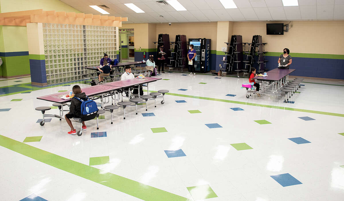 M.S. Ryan Elementary School students are distanced while they have breakfast before heading to their class room, Aug. 24, 2020, during the first day back to school for some students during the COVID-19 Coronavirus pandemix.