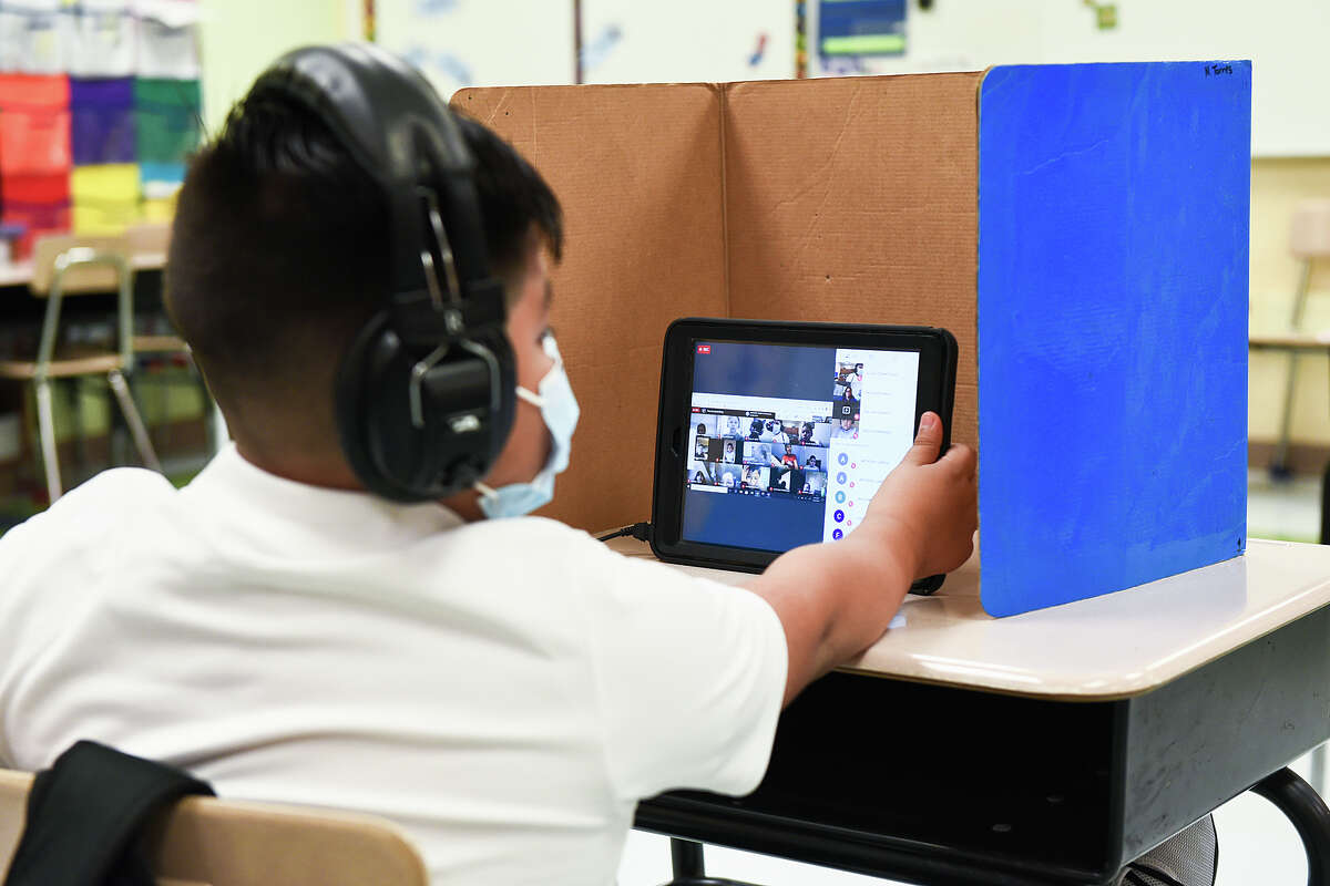 M.S. Ryan Elementary student Elias Lozano check in with his teacher in their virtual classroom, Aug. 24, 2020, during the first day back to school for some students during the COVID-19 Coronavirus pandemix.