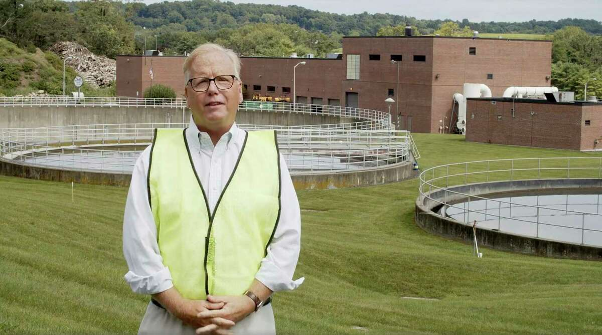 Danbury Mayor Mark Boughton stands in front of the Danbury Wastewater Treatment Plant in Danbury, Conn., as he announces a tongue-in-cheek move to rename the facility after John Oliver following the comedian's expletive-filled rant about the city.