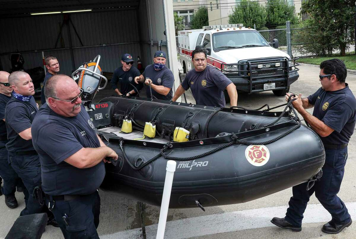 Firefighters from Houston Fire Station 11 prepare water-rescue equipment Monday, Aug. 24, 2020, at HFD Station 11 in Houston. Tropical weather systems are expected to hit Texas and Louisiana later in the week.