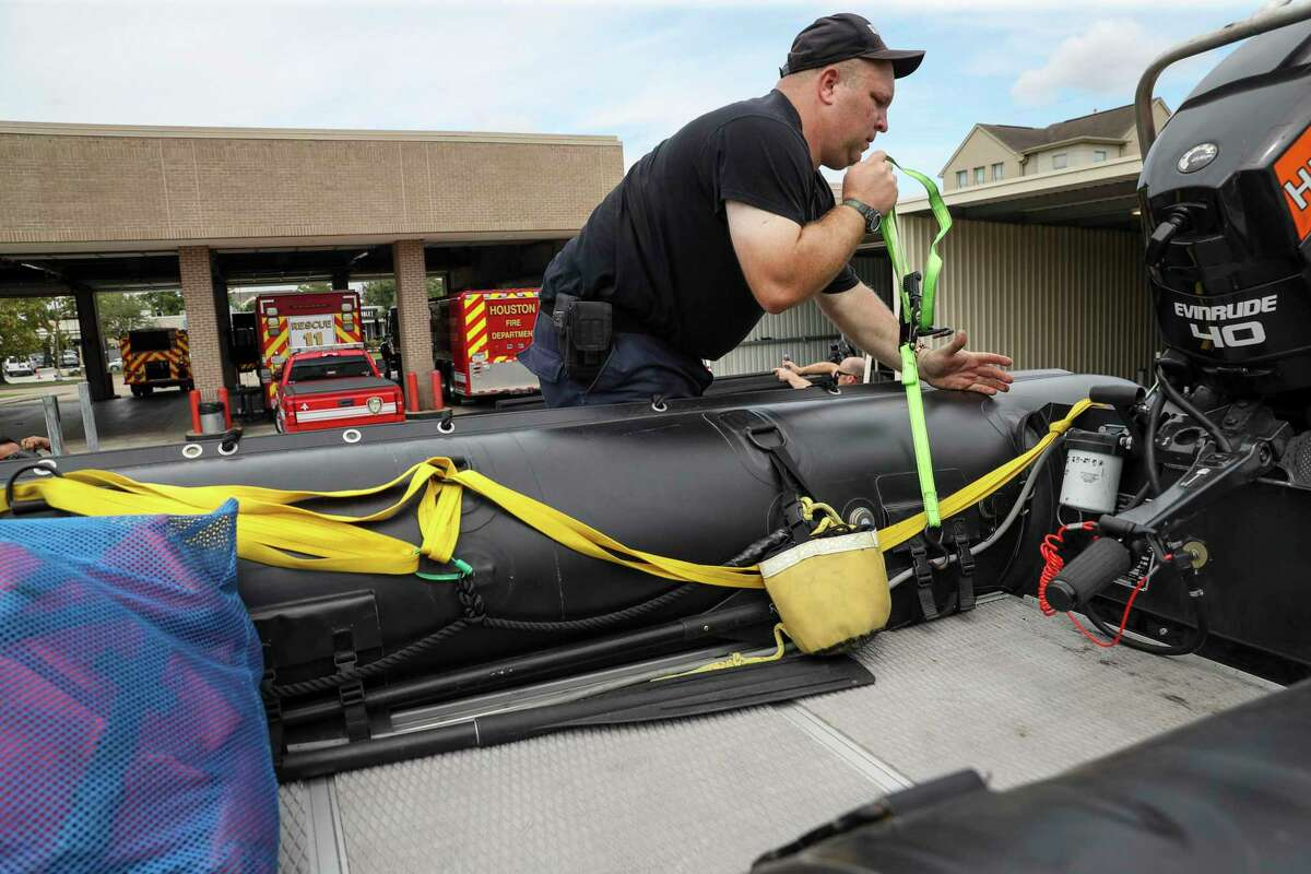 Houston Firefighter Paul Kessler prepares water-rescue equipment Monday, Aug. 24, 2020, at HFD Station 11 in Houston. Tropical weather systems are expected to hit Texas and Louisiana later in the week.