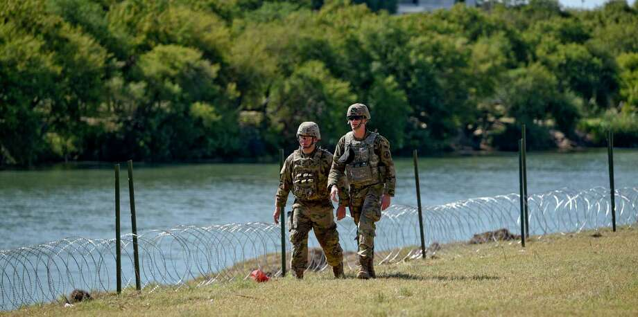 Members of the U.S. military walk along the banks of the Rio Grande in Laredo as they installed concertina wire in this Nov. 16, 2018 file photo. U.S. Customs and Border Protection said that another installation of wire is not imminent. Photo: Danny Zaragoza /Laredo Morning Times / Laredo Morning Times