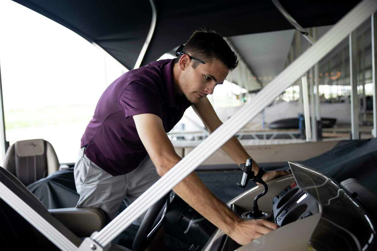Alex Cade, manager at the Palms Mariana prepares a boat for the possibility of inclement weather as Tropical Storm Laura approaches the area, Monday, Aug. 24, 2020, in Conroe. Tropical Storm Laura is expected to make landfall Wednesday night according to the National Weather Service.