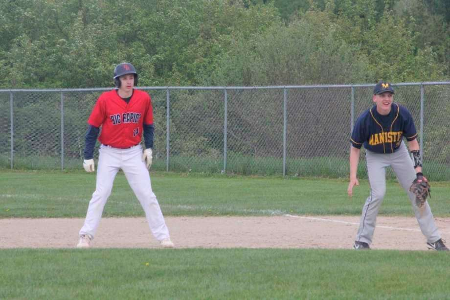 Big Rapids' Keaton Ballard (14) gets a lead off first base in action. (Pioneer file photo)