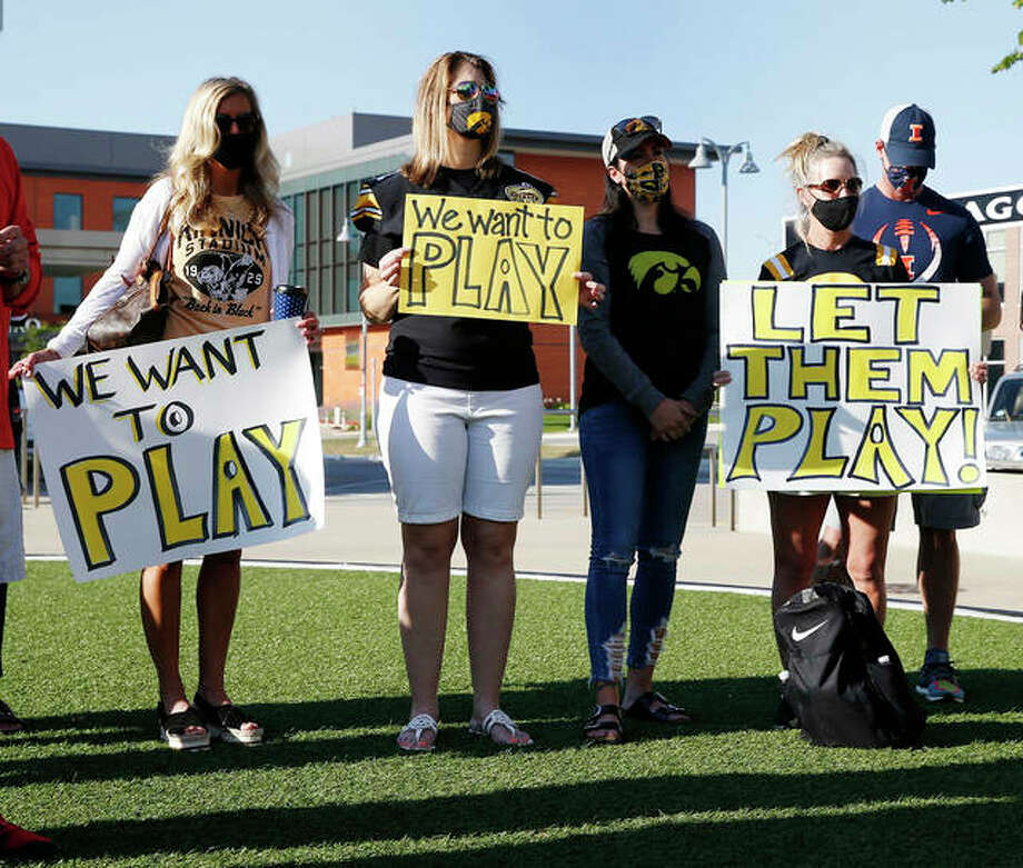 Parents of Iowa football players protest outside Big Ten headquarters in Rosemont on Friday. Parents of Big Ten football players, upset over the process that led to the postponement of the season until spring, held a protest near the conference's Chicago-area headquarters Friday while an attorney in Nebraska demanded commissioner Kevin Warren turn over material illustrating how the decision was made. Photo: Associated Press
