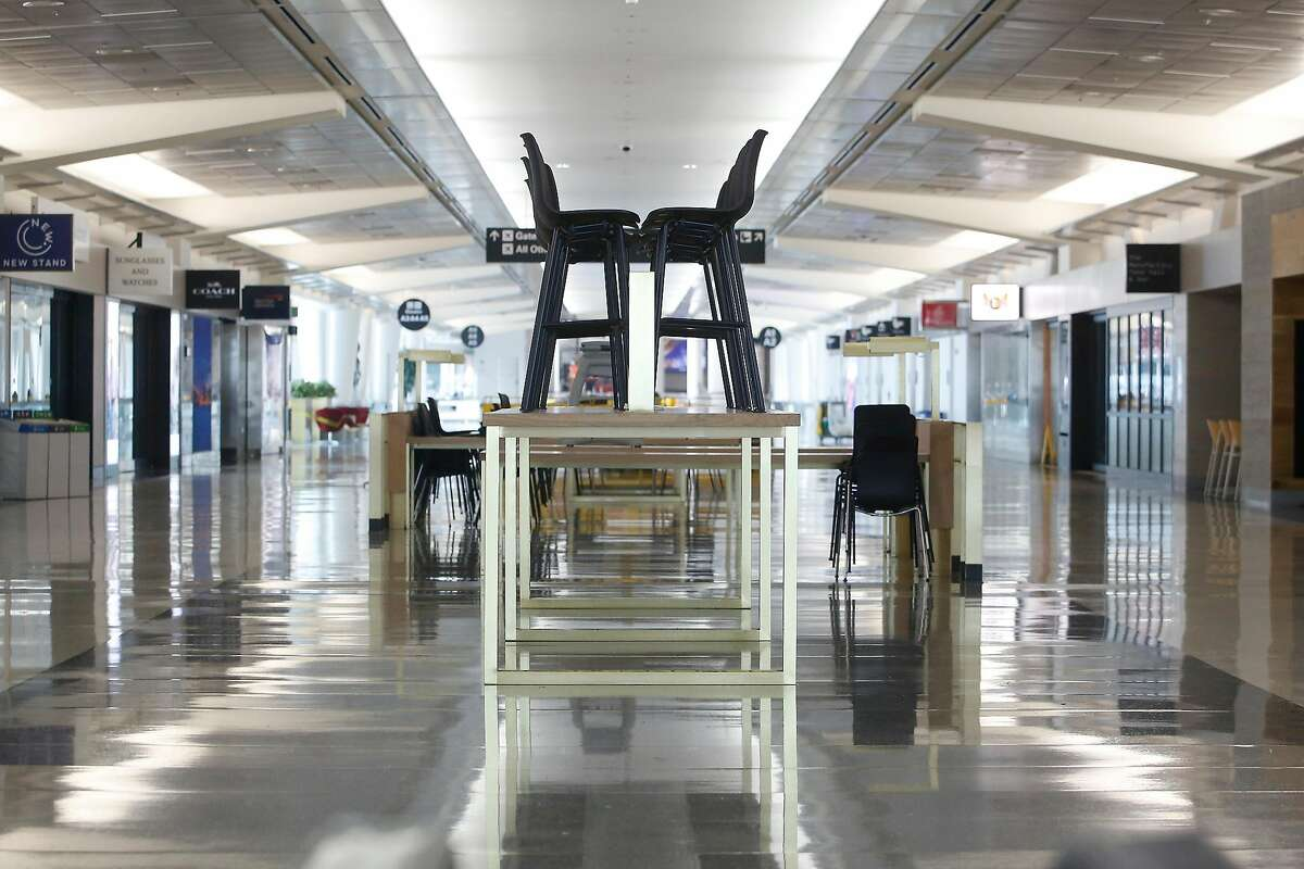 Chairs are seen atop a table in Concourse A of the SFO International Terminal on Monday, August 24 2020 in San Francisco, Calif. Concourse A in the International Terminal at SFO has been shut since April due to the pandemic.