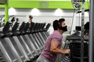 Nick Isom of Guilderland works his upper body at Vent Fitness Guilderland during the first day of gym reopening under the state's coronavirus reopening plan on Monday, Aug. 24, 2020, in Guilderland, N.Y. (Will Waldron/Times Union)