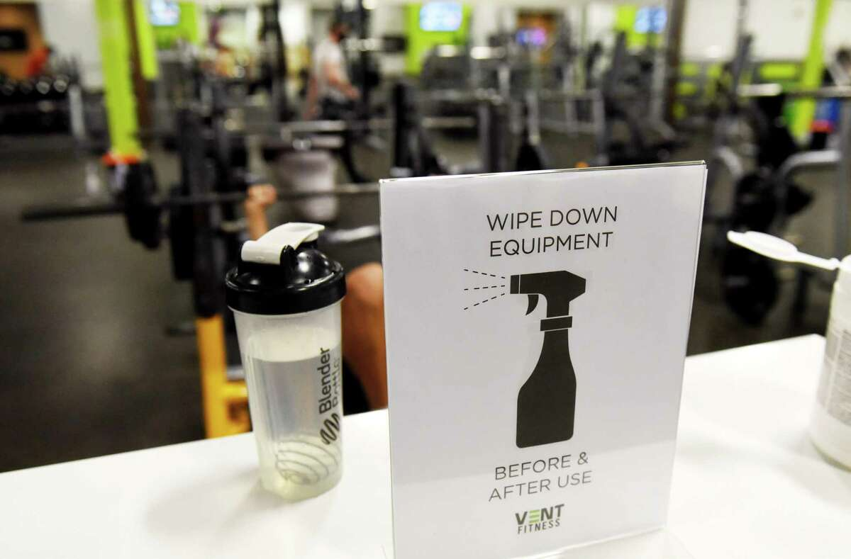 Gym equipment cleaning is asked of users at Vent Fitness on Monday, Aug. 24, 2020, in Guilderland, N.Y. New York gyms reopened Monday under the state's coronavirus reopening plan. (Will Waldron/Times Union)