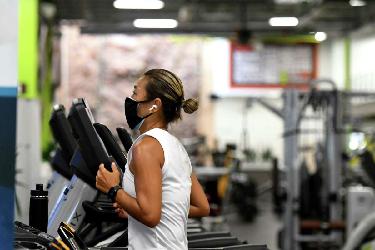 Grace Ng hits the treadmill at Vent Fitness during the first day of gym reopening under the state's coronavirus reopening plan on Monday, Aug. 24, 2020, in Guilderland, N.Y. (Will Waldron/Times Union)