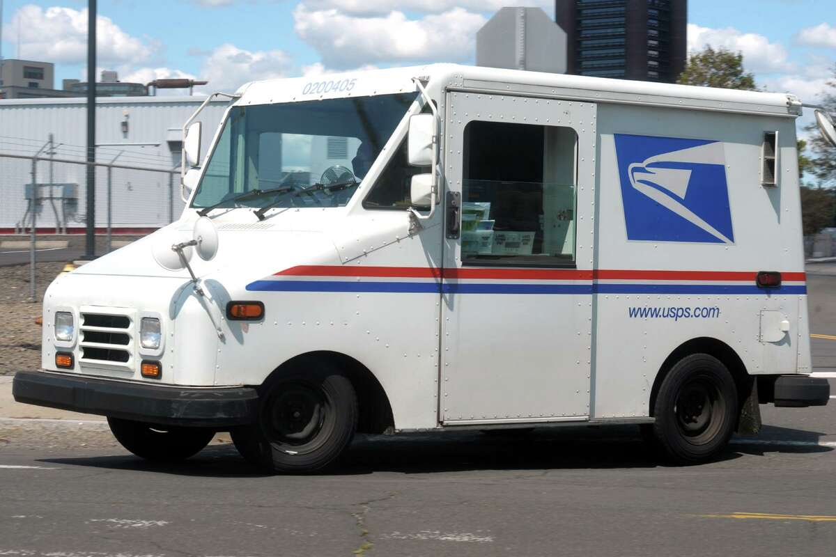 A United States Postal Service truck departs the General Post Office in New Haven, Conn. Aug. 20, 2020.