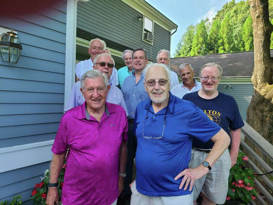 It may still be summer, but the Wilton Kiwanis Club is getting ready for its annual pumpkin sale. On hand to help are, in front, Paul Hannah, left, and Bud Taylor. Second row from left, Ray Tobiassen, Jeff Turner, Mike Borcaino and Dan Mahoney. Behind them are Mike Borcaino and Dan Mahoney. Behind Mike Safko is Marty Clancy. Photo: Wilton Kiwanis Club / Contributed Photo / Wilton Bulletin Contributed