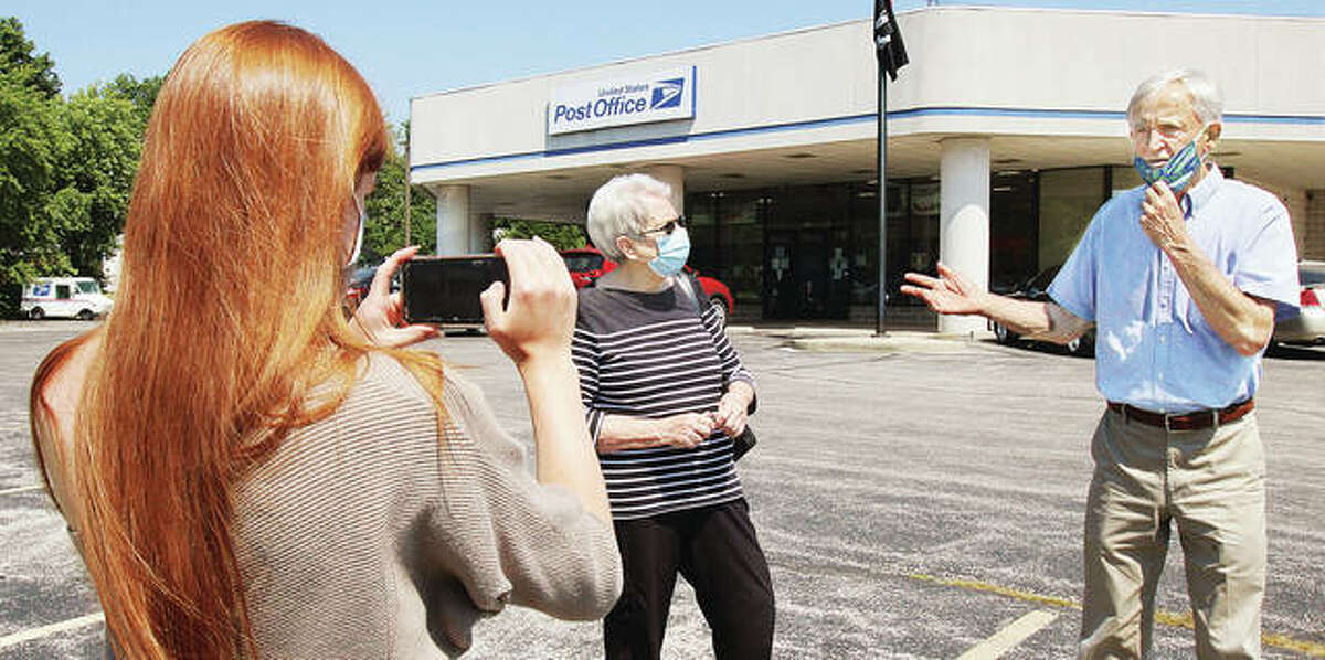 A Ray Lenzi campaign staff member, left, makes a video of his conversation with Mary Lou Beck, center, of Alton, Monday outside the main Alton Post Office. Beck approached Lenzi to tell him about a very slow mail experience she had. Lenzi, the Democratic candidate for the 12th Congressional District, ended a four-day tour of regional postal facilities in Alton on Monday, calling on for incumbent U.S. Rep. Mike Bost, R-Murphysboro, to stand up for efficient and safe mail-in voting procedures.