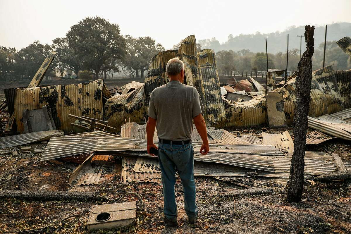 David Hill looks over the charred remains of his property after the LNU Lightning Complex fire tore through the area on Monday, Aug. 24, 2020 in Vacaville, California. David has owned the property since 1981 and built the property himself.