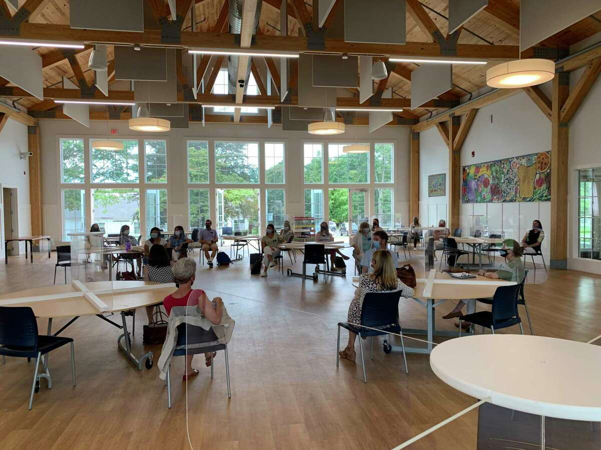 New Canaan Country School held an orientation for new faculty and staff in their Carver Cafeteria, modified to guard against the spread of COVID-19, this week.