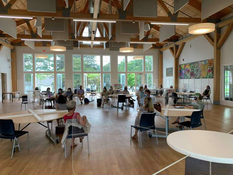 New Canaan Country School held an orientation for new faculty and staff in their Carver Cafeteria, modified to guard against the spread of COVID-19, this week. Photo: New Canaan Country School / Contributed Photo / New Canaan Advertiser