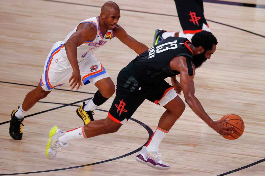 PHOTOS: A look at Game 4 of the Rockets-Thunder series Houston Rockets' James Harden (13) drives past Oklahoma City Thunder's Chris Paul (3) during the second quarter of Game 4 of an NBA basketball first-round playoff series, Monday, Aug. 24, 2020, in Lake Buena Vista, Fla. (Kevin C. Cox/Pool Photo via AP) Photo: Kevin C. Cox, Associated Press / 2020 Getty Images