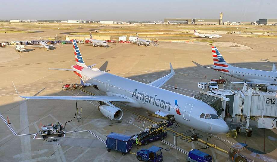 (FILES) In this file photo An American airlines plane is seen at Dallas Ft Worth International Airport at the gate on August 23, 2020. - American Airlines on August 24, 2020 said it will be spraying its airplane interiors with a long-lasting product specifically designed to guard against the coronavirus as it tries to coax passengers back into flying. The Texas-based carrier said in a statement it will begin using SurfaceWise2, a newly approved anti-viral surface coating aimed specifically at killing the virus causing COVID-19. (Photo by Daniel SLIM / AFP) (Photo by DANIEL SLIM/AFP via Getty Images) Photo: Daniel Slim, AFP Via Getty Images