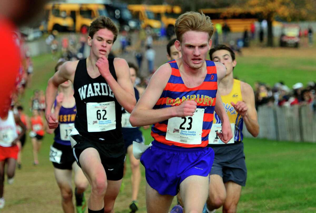 Danbury's Jacob Hefele crosses the finish line during Class LL cross country championship action in Manchester, Conn., on Saturday Oct. 26, 2019.