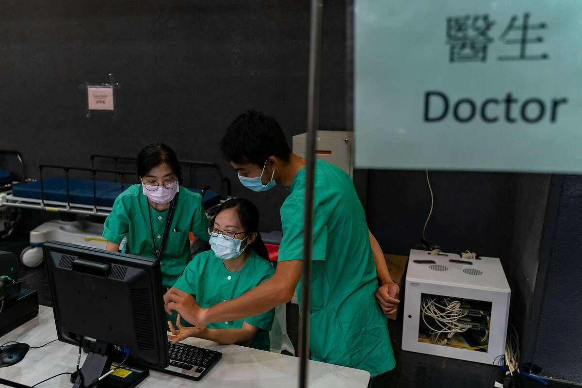 HONG KONG, CHINA - AUGUST 01: Medical workers make preparations ahead of the first lot of patients arrival at Asia World Expo on August 1, 2020 in Hong Kong, China. AsiaWorld-Expo has been converted into a makeshift hospital that can take up to 500 patients. A group of seven mainland health officials will arrive in Hong Kong on Sunday as the first members of a 60-strong team that will assist with testing for Covid-19 as the city is expected to record more than 100 new confirmed cases on Saturday, the 11th day in a row with triple-digit increases.(Photo by Anthony Kwan/Getty Images)
