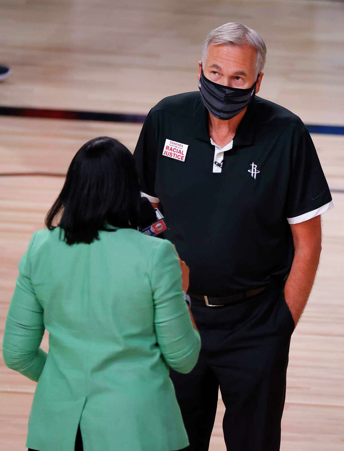 Houston Rockets head coach Mike D'Antoni, right, is interviewed after the first quarter of Game 4 of an NBA basketball first-round playoff series against the Oklahoma City Thunder, Monday, Aug. 24, 2020, in Lake Buena Vista, Fla. (Kevin C. Cox/Pool Photo via AP)
