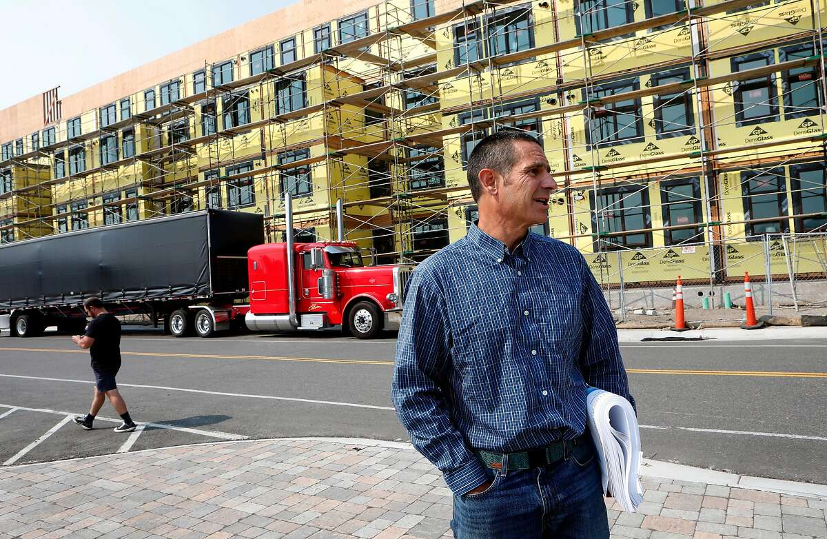 Jason Hansford, with the Truckee Development Associates and managing partner in Truckee Railyard project in Truckee, Ca., on Thurs. Aug. 20, 2020. In front of the Truckee Artist Lofts project which is still under construction.