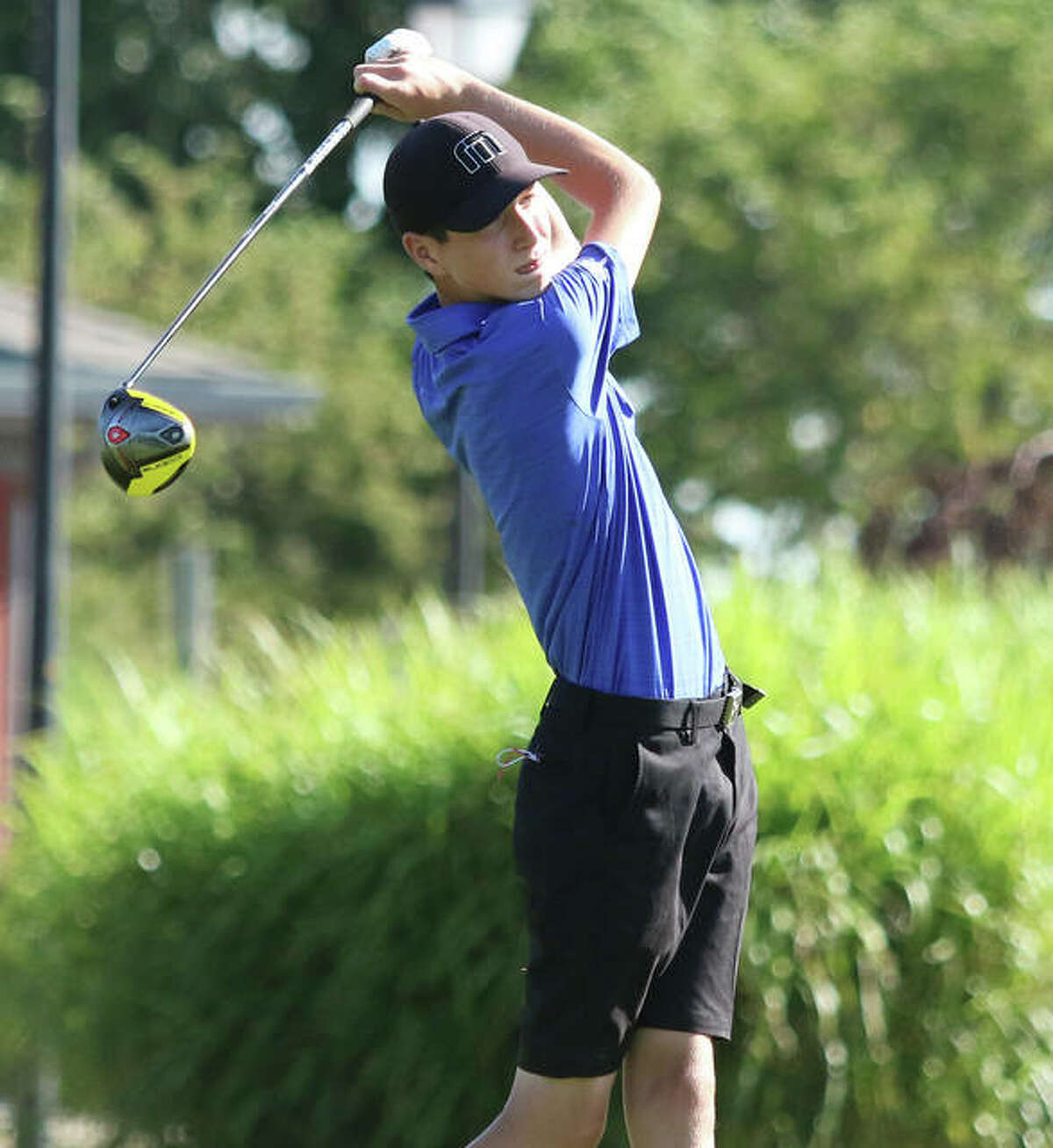 Marquette sophomore Aidan O'Keefe hits a drive from hole No. 1 on Monday at the Hickory Stick Invitational at Belk Park. O'Keefe shot 77 to place fifth in the tourney.
