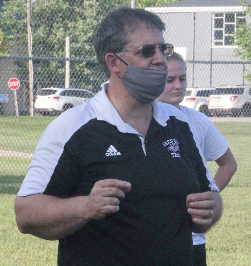 Reed City volleyball coach Don Patterson talks to his team at a recent outdoor practice. (Pioneer photo/John Raffel)
